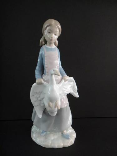 figura porcelana nao niña y ganso catálogo numero 02010114