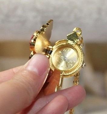 finisimo y exclusivo reloj cruz con piedras y cadena