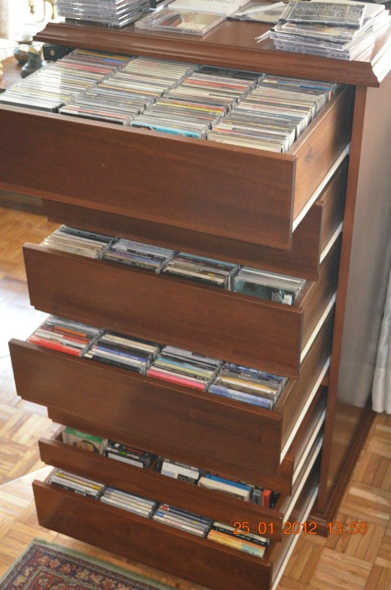 fino mueble para guardar cds puerta vidrio