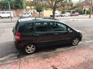 fit 1.4 lxl aut. 2004 5p bx km  revisado + couro + rodas