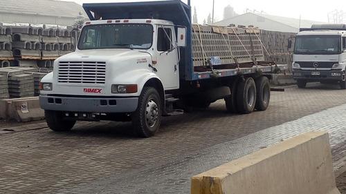 fletes camion plano con carga y descarga con grua horquilla