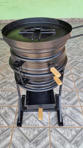 fogão a lenha feito de roda de carro