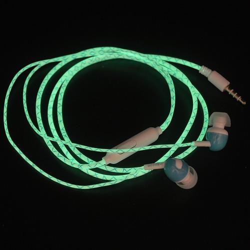 fone de ouvido que brilha no escuro verde