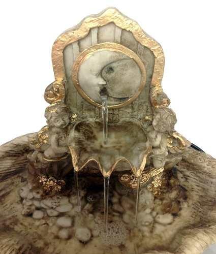 fonte decorativa cascata lua dourada.