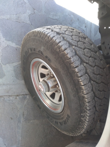 ford f150, 86 (4x4) color grises.