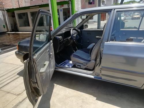 ford festiva, motor 1300 cc. 1995, gris, 5 puertas