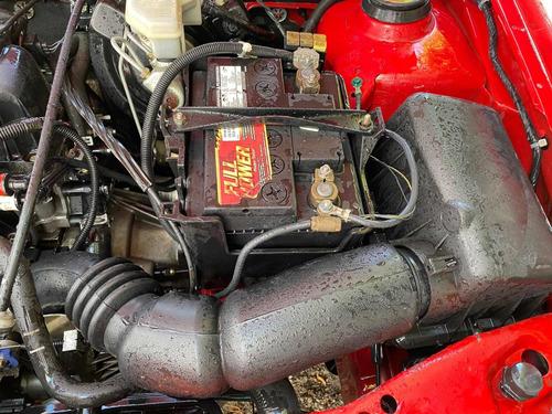 ford ikon rojo austero
