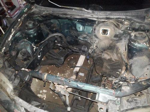 ford láser98 sin motor ni caja ni tapiceria tal como esta