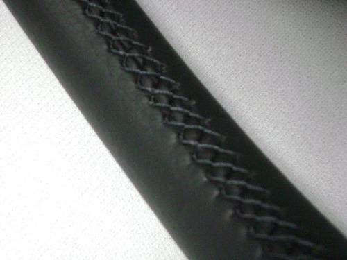 forrado de timòn en cuero natural: costuras a mano tipo full