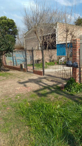 frente de rejas con portón corredizo