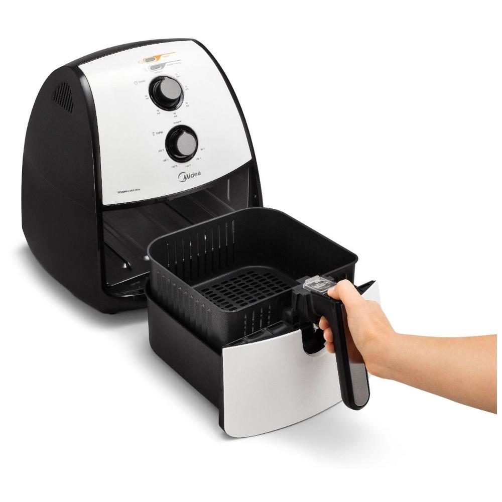2b374ade2 fritadeira sem oleo air fryer midea 4 litros 1500w fra41. Carregando zoom.