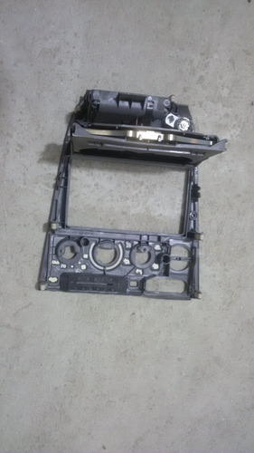 frontal marco consola central tablero corolla 99-02 original