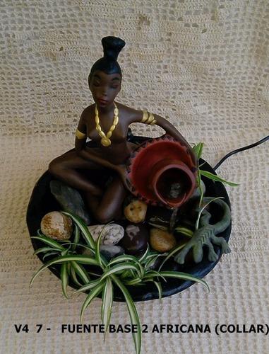 fuente de agua africana con collar