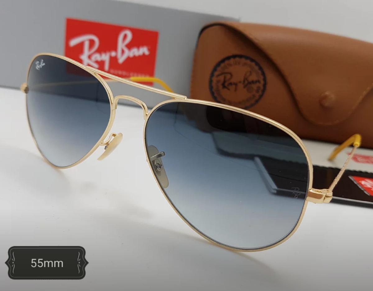 cacc6fd2441ce gafas rayban piloto 55mm marco dorado lente azul degrade vis. Cargando zoom.