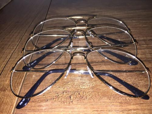 gafas transparentes, marco dorado