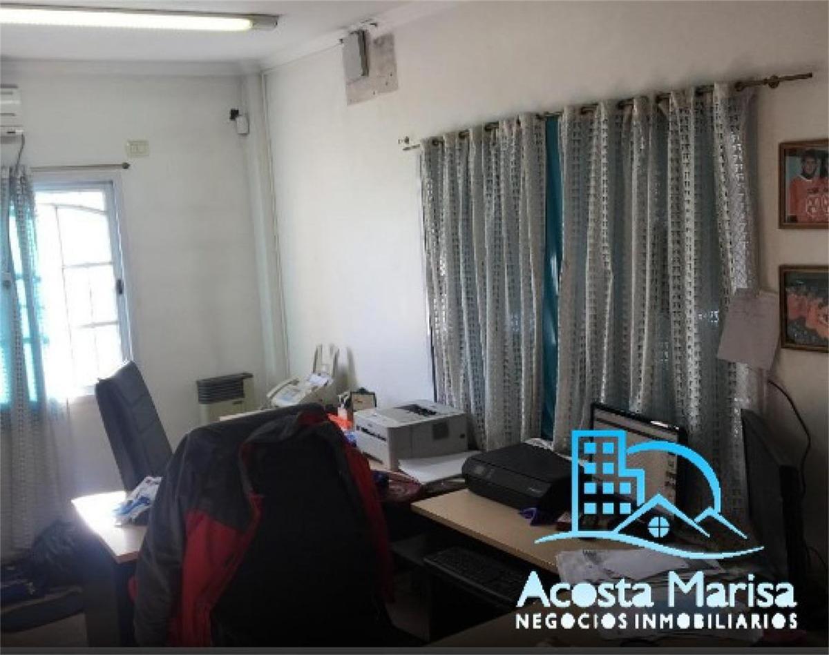 galpón de dos plantas (losa + parabólico) y oficinas