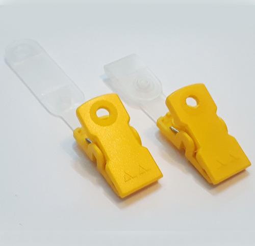 gancho caimán plástico para porta carnet  (la docena)