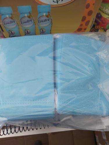 gel antibacterial y cubre boca grueso y plizado