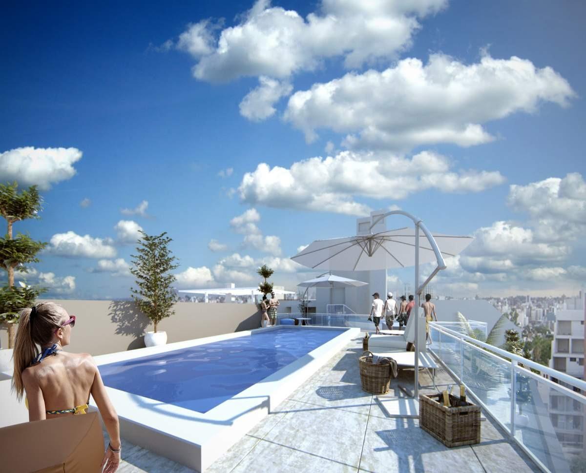 general paz 1 dorm edificio con cocheras, terraza con asadores  y piscina