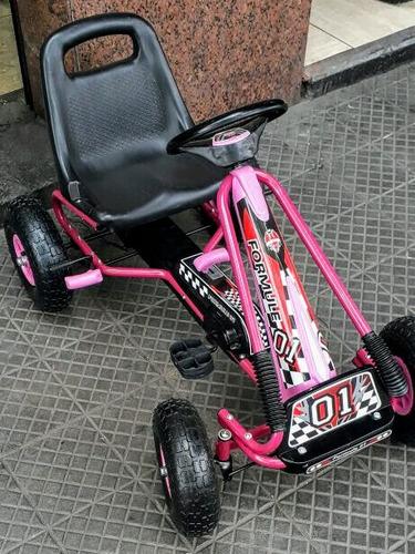 go kart, auto a pedales rosado, rojo y azul