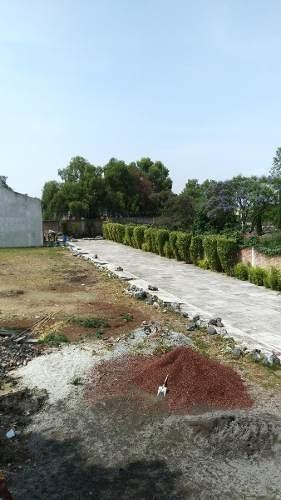 gran terreno con construcción obra gris, locales y casa