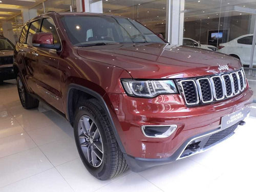 grand cherokee limited año 2018 dos colores bordo y negrra