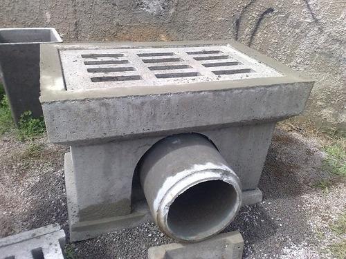 grelha de concreto e boca de lobo