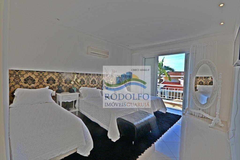 guarujá acapulco - altissimo padrão - 4 suítes - 4 vagas - 420 mts área construida. - ca0007