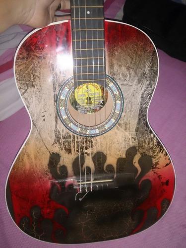 guitarra acustica poco uso..! con su forro nuevo