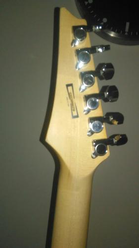 guitarra eléctrica ibanez absolutamente cómo nueva.