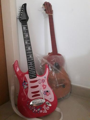 guitarra electrica y cuatro