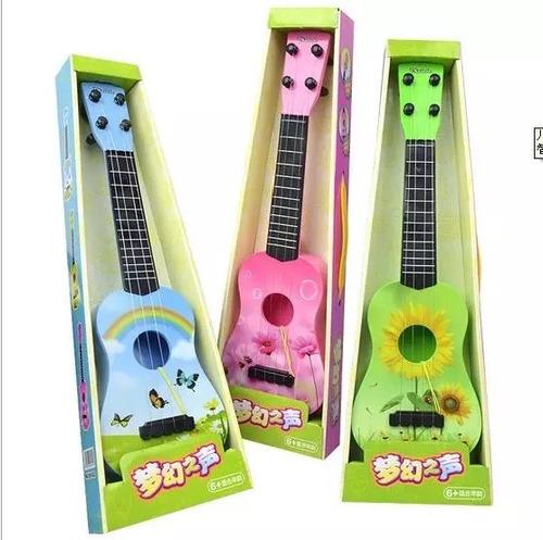 guitarra infantil más uñeta