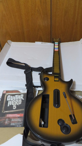 guitarra y juego guitar hero 5 para wii chipeada.