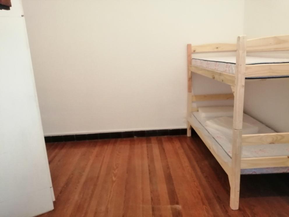 habitación compartida en apartamento