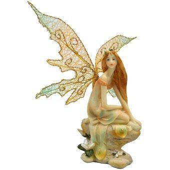 hada sentada piedra flor
