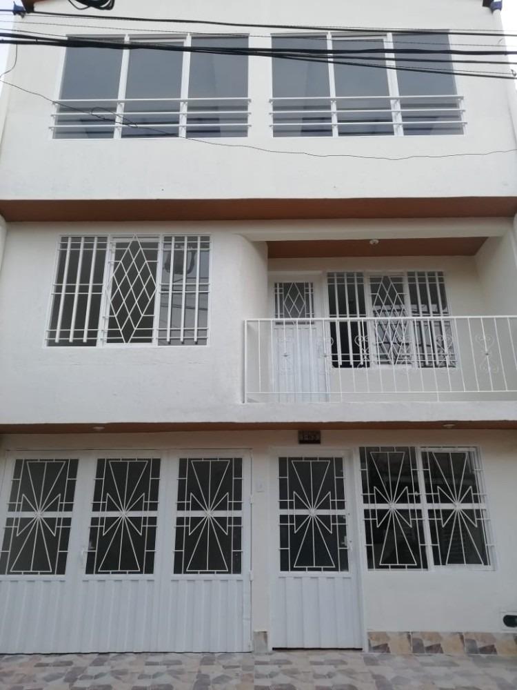 hermosa casa de 3 pisos, vista panorámica y garaje