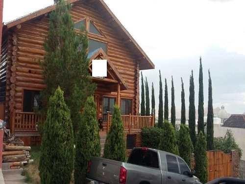 hermosa casa, estilo cabaña, en fracc. privado, con dos terrazas, y fuente em jardín y bodega