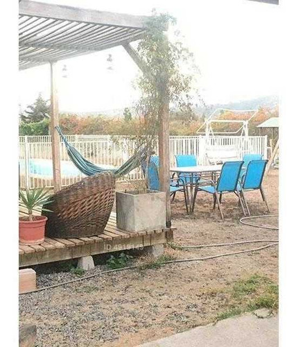 hermosa casa térmica en parcela de 5.300 m2 con piscina; a 15 minutos del centro de quillota y 20 minutos de con con.