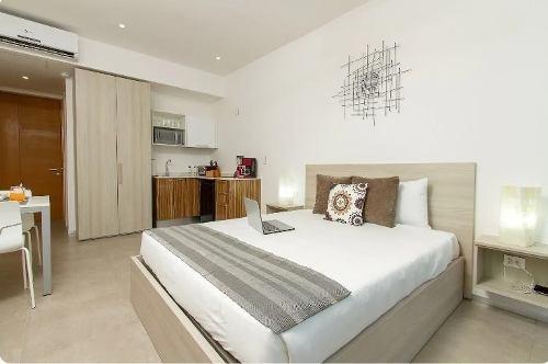 hermoso estudio en venta en condominio the city playa del carmen  p3002