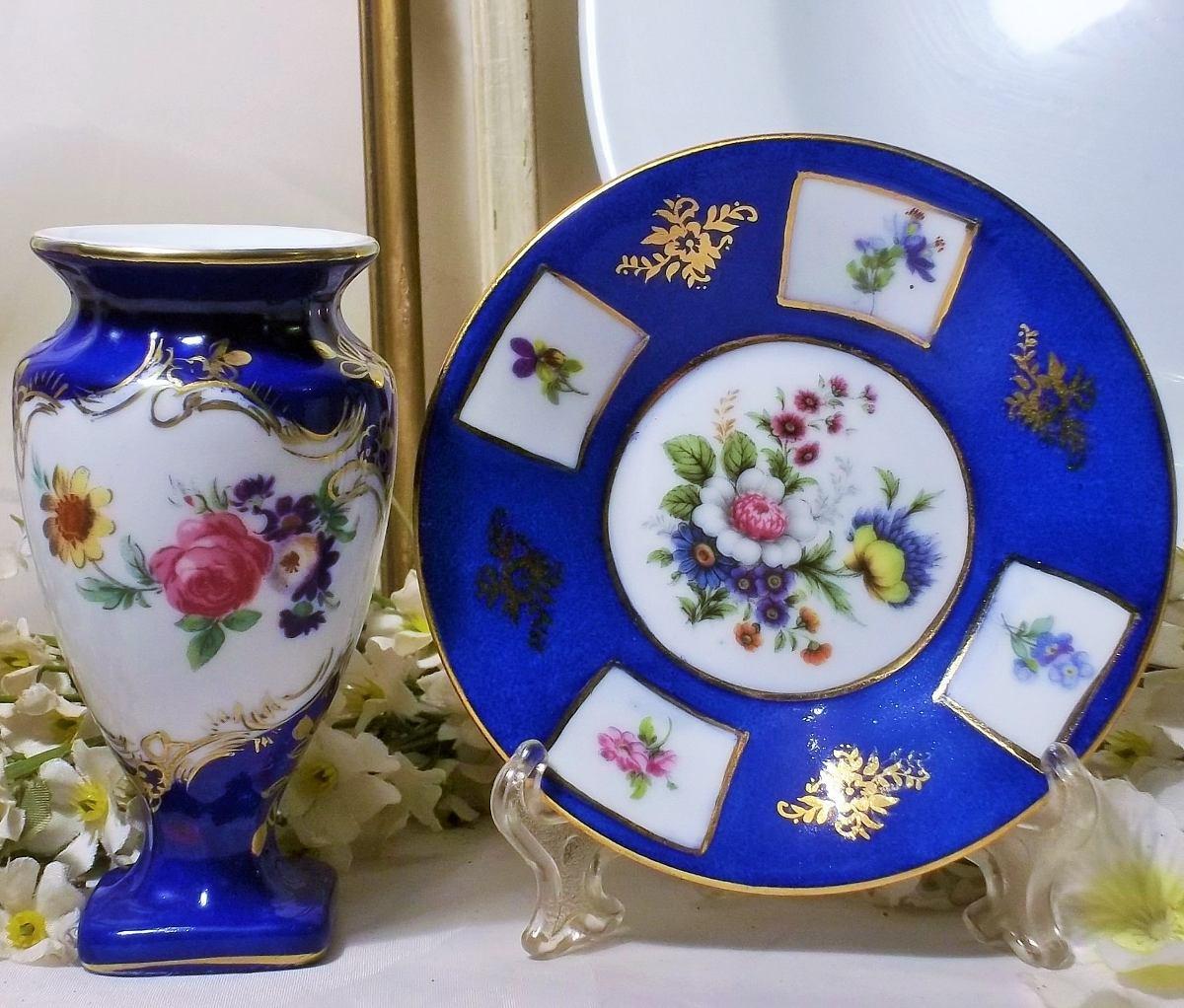 hermoso florero y plato porcelana azul precio por los dos