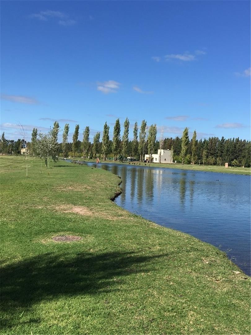hermoso lote junto al lago con vista al atardecer miralagos