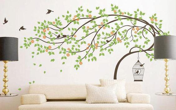 hermoso vinilo decorativo arbol con hojas volando y jaula