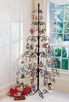 hermoso y original pino de navidad de metal $8500