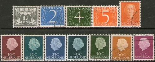 holanda 12 sellos usados cifras y reinas años 1935-53