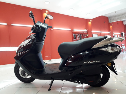 honda elite 125cc.  impecable!!! con parabrisas.