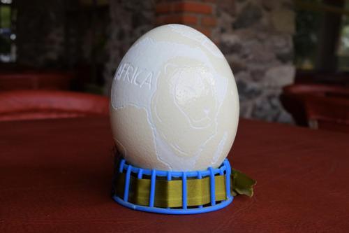 huevo avestruz tallado a mano jirafa áfrica y león