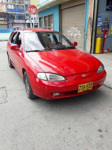 hyundai elantra.motor 1800,rojo 5 puertas.