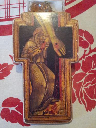 ícono en forma de cruz de la figura de san francisco asis.