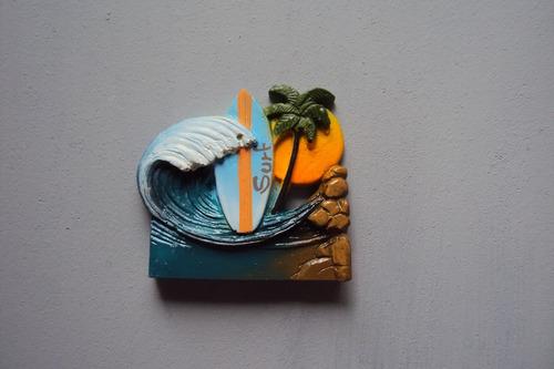 imã para geladeira tema praia e mar.
