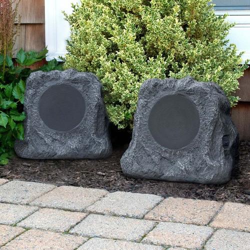 increíbles bocinas para exteriores jardin en forma de roca
